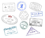 Various countries passport stamps. On white background Stock Photography