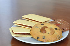 Various crackers and cookies on plate Stock Photos