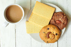 Various crackers, cookies on plate with coffee Royalty Free Stock Photography