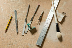Various Craft Tools on Work Wooden Tabletop stock image