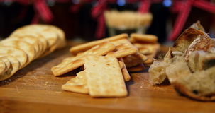 Various crispy biscuits and bread on counter. In supermarket stock footage