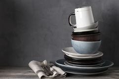 Various crockery on kitchen table Royalty Free Stock Photo