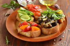 Various crostini with vegetables and herbs Stock Photography