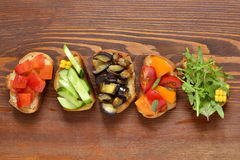 Various crostini with vegetables and herbs Royalty Free Stock Photography