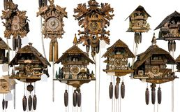 Various cuckoo clocks. Some wooden cuckoo clocks in white back Stock Image