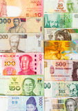 Various currencies banknotes forming a background Stock Photos