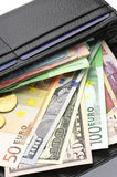 Various currencies in purse Stock Photography