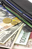Various currencies in purse. Close-up Royalty Free Stock Photo
