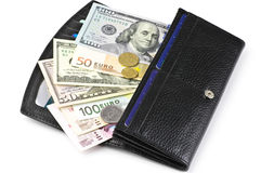 Various currencies in purse Royalty Free Stock Photos