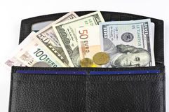 Various currencies in purse. On white background Stock Image