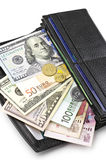 Various currencies in purse Stock Photo