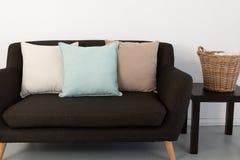 Cushions arranged on sofa stock images