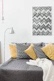Various cushions in cozy bedroom Royalty Free Stock Photo