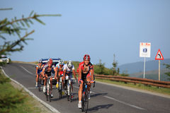 Various cyclists climbing on the road to Paltinis, Romania. Paltinis, Sibiu, Romania - 5 July 2012: Sibiu Cycling Tour 2012 - Stage I. Cyclists climbing the Stock Photography