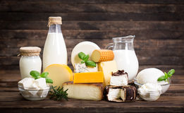 Various dairy products. On the wooden background Stock Photos