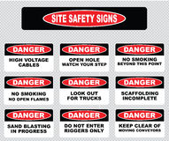 Various danger sign, site safety signs. (high voltage cables, open hole watch your step, no open flame, no smoking, look out for trucks, scaffolding incomplete Royalty Free Stock Photo