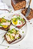 Various danish open sandwiches Smorrebrod. Set of various danish open sandwiches Smorrebrod with fish, egg and fresh vegetables, white marble background copy Royalty Free Stock Photos