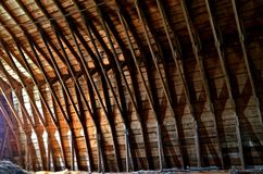 Rafters in a barn hay loft. Various degrees of light exposes the hay loft rafters of an old barn stock images