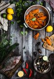 Various delicious seafood with lemons and herbs on rustic wooden table. Top view of various delicious seafood with lemons and herbs on rustic wooden table Royalty Free Stock Photos