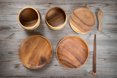 Various design empty plates on wood desk Stock Images
