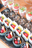 Various dessert with fresh fruit on buffet line Stock Photo