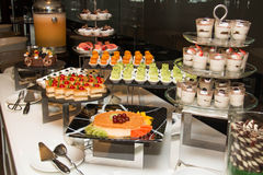 Various dessert with fresh fruit on buffet line Stock Photography