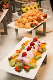 Various dessert with fresh fruit on buffet Stock Image