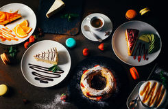 Various desserts. Cakes and coffee on a dark background. View from above stock photo