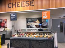 Various cheese in a store display. Royalty Free Stock Photography
