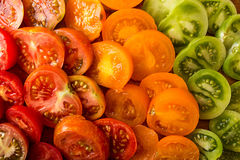 Various different color organic homegrown tomatoes on board. Cut Stock Photo