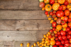 Various different color organic homegrown tomatoes on old wooden Royalty Free Stock Photos