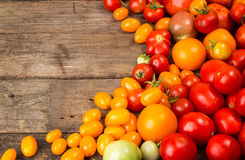 Various different color organic homegrown tomatoes on old wooden Stock Photos