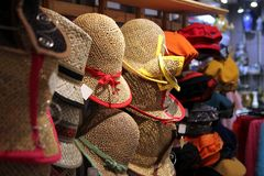 Various different colored straw hats for sale in a boutique. Various different colored straw hats for sale in a fashionable boutique Royalty Free Stock Image