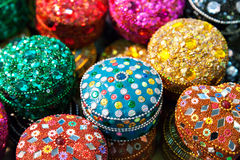 Various of different colorful jewel boxes in Indian market Royalty Free Stock Photo