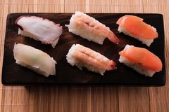 Various different sushi japanese food salmon prawn wood platter. Various different sushi japanese food wood platter Stock Photography