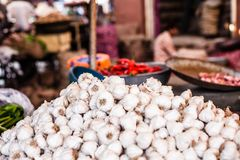 Various different vegetables and mango in wooden baskets at the market, Kumly, Kerala, India Royalty Free Stock Image