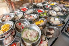 A various of Dim Sum streamer dumplings served on small stainless-steel plates in a local chinese restaurant at Betong, Yala,. Near the Malaysian border, top royalty free stock photos