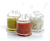 Various Dips. In Glass Jars On White Background royalty free stock photos