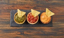Various dips from above. Various dips on wood from above stock image