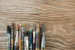 Various dirty paintbrush arranged in a row Royalty Free Stock Photography
