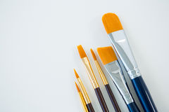 Various dirty paintbrushes arranged in a row Stock Image
