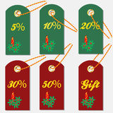 Various discount tags & labels with Christmas symbols Royalty Free Stock Photo