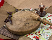 Various djembes and tambourine in front of a rustic wall. Stock Photo