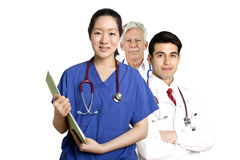 Various Doctors standing in front of white background Royalty Free Stock Photography