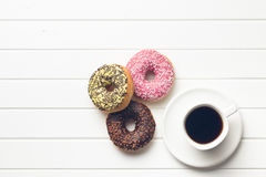 Various donuts with coffee stock photos