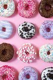 Various donuts on a colorful background. Top view shot. Stock Image