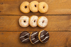 Various donuts on wood Royalty Free Stock Images