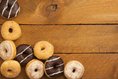 Various donuts on wood Stock Photography