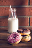 Various donuts on wooden table stock photos