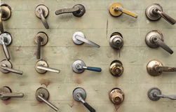 Various door handles. Are displayed on the panel Royalty Free Stock Photography